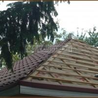 Tigla rosie acoperis casa in lucru